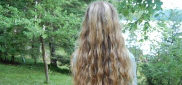 Healthy and curly blond hair