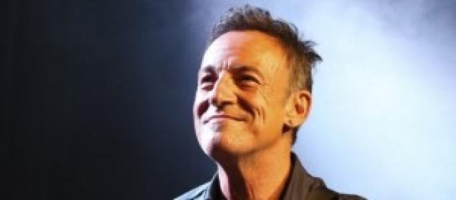 Springsteen sonriente en un concierto