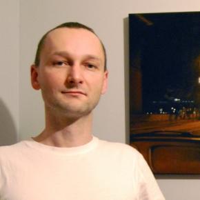 Łukasz Jacek i jedno z jego krakowskich dzieł.