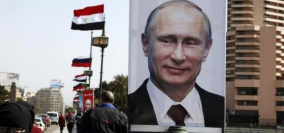 Putin's photo in Syria. Russian flags at the back.