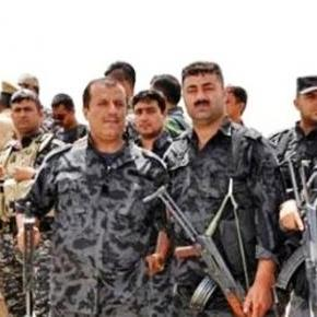 Peshmerga fighters wearing uniforms