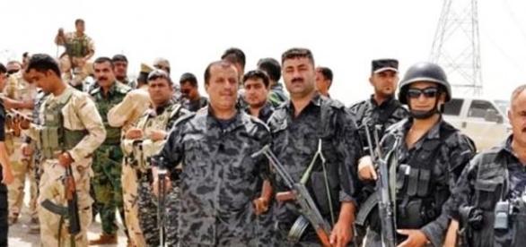 Peshmerga fighters wearing uniforms