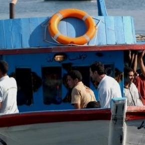 Boat carrying migrants off the coast of Lampedusa