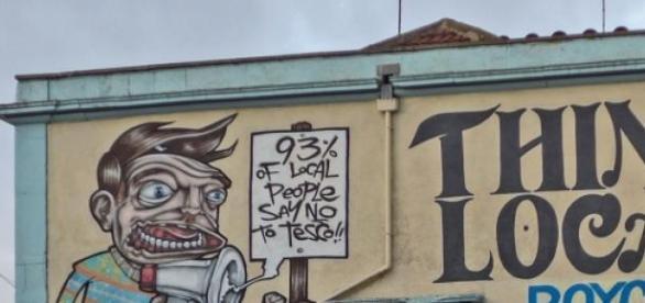 Street art in Stokes Croft via Wikipedia commons.