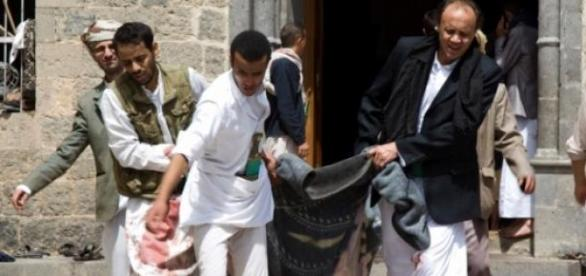 Volunteers carrying the victims in blankets