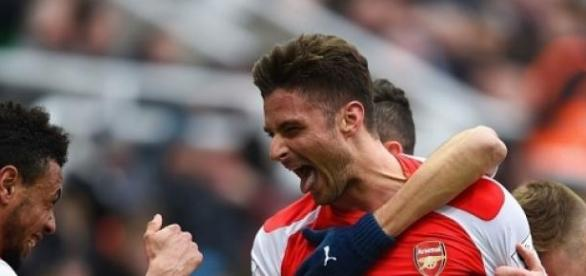 Olivier Giroud celebrates his brace for Arsenal