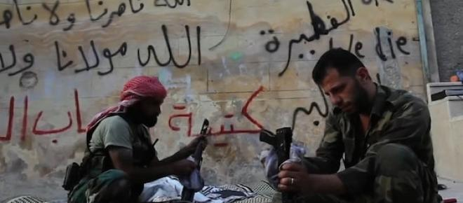 Free Syrian Army rebels cleaning their weapons in a war torn country.