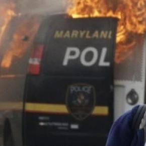 A police van in Baltimore set ablaze