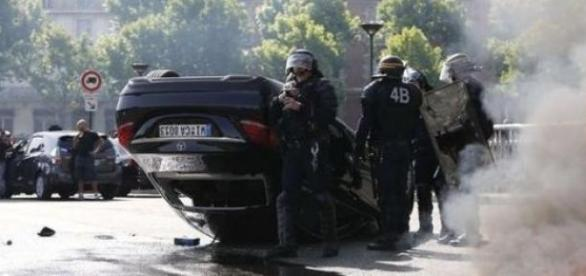 Riot police in the French capital. Image by BBC