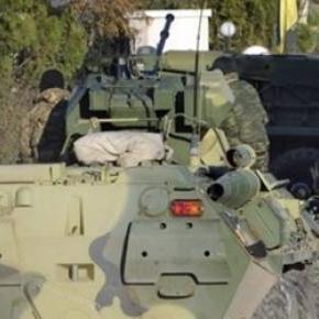 Ucraina comasează trupe şi armament greu
