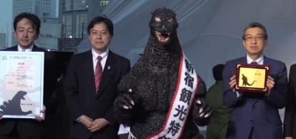 Godzilla receiving his Resident Certificate