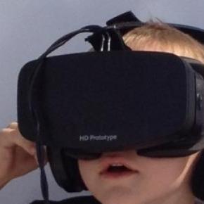 Boy wearing a prototype of Oculus Rift.