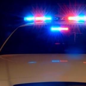Maşină de poliţie la locul crimei