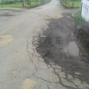 credits, own picture : Pot holes like this are found on most roads in the town