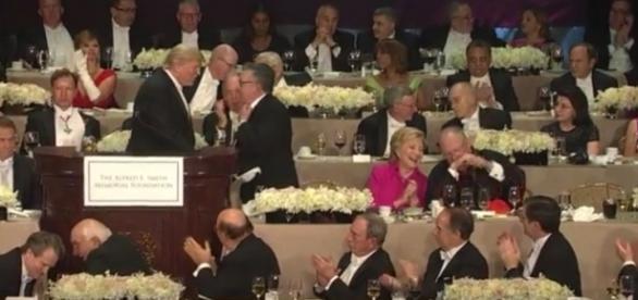 Hillary Clinton laughs it up with cardinal after Donald Trump gives awkward and embarrassing speech / photo via screenshot, CBS Network