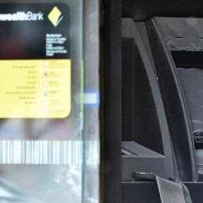 An ATM machine is burned at a branch of the Commonwealth bank