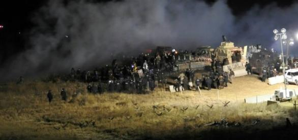 Photo provided by Morton County sheriff's officials show law enforcement and demonstrators squaring off Sunday. -- Morton County Sheriff's Department