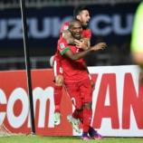 Indonesia's Boaz Solossa and Stefano Lilipaly celebrate the winning goal