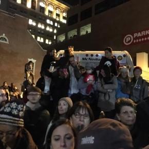 Rally-goers sit on a garbage truck, a block away, to hear Hillary Clinton's rally, 11/7/2016 (Stephen Silver)