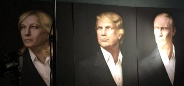 La o petrecere organizată de extrema dreapa pro-Kremlin din Moscova a fost afișat o pictură cu Tump, Putin și Marine Le Pen - Foto: Twitter
