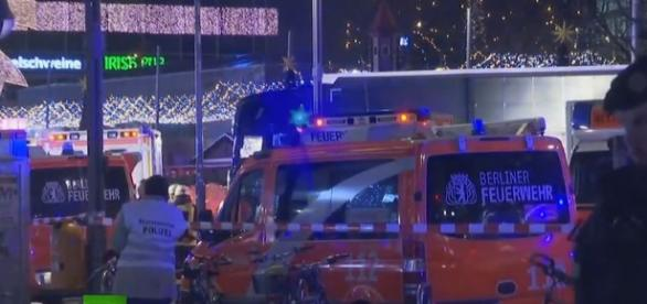 Truck plows into Christmas market in Berlin in likely terrorist attack - aftermath photo screencap from RT via Youtube