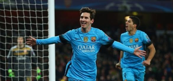 Lionel Messi celebrates scoring his second goal