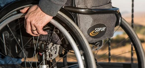Man sitting in wheel chair (pixabay)