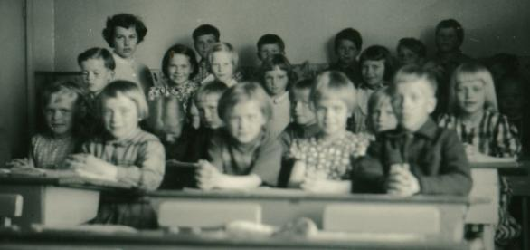 Children in school setting circa 1900 courtesy Flickr