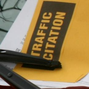 Parking citation on windshield (Wikimedia)