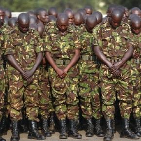 Kenyan troops pay respect to those killed by Al-Shabab / AP Photo, John Muchucha