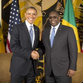 President Obama and President Sall shake hands after a bilateral meeting in Dakar, Senegal / Photo via Houston Chronicle