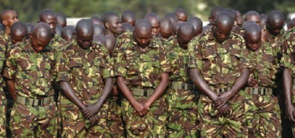 Kenyan troops pay respect to those killed by Al-Shabab / AP Photo, John Muchucha