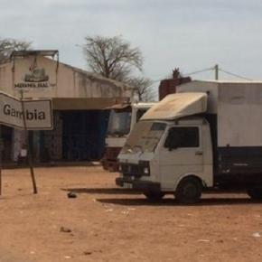 A truck sits for days at The dusty Gambia-Senegal border / Photo via Alhagie Jobe