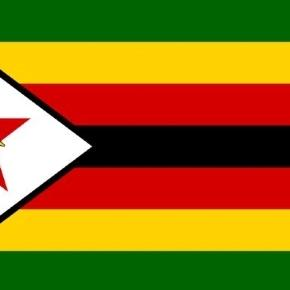 The Zimbabwe national flag / Image via public domain Wikimedia.