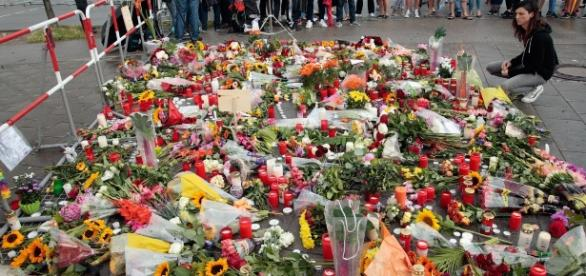 People leave floral tributes for those murdered in Munich. Photograph: Johannes Simon/Getty Images