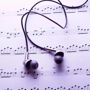 Musical notes and earbuds / Photo via Geoffrey Whiteway, Free Range Stock