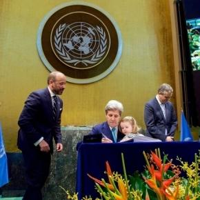 Secretary of State John Kerry signing Paris climate accord. Wikipedia-State Dept.