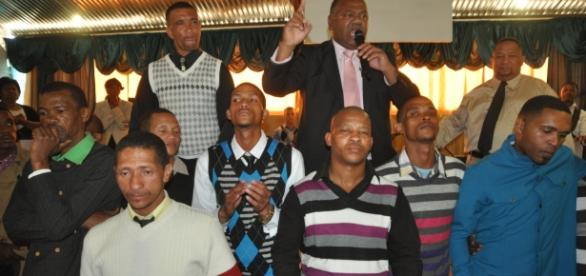 Dan Plato, at the back is the Western Cape minister of community safety. Here he converts deveral gangsters to the church. {Picture: Fu'ad Rahman