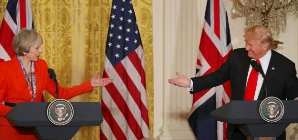 Theresa May says Trump visit will go ahead despite petition ... - businessinsider.com