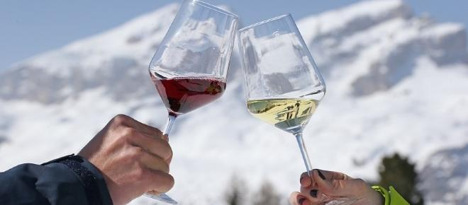 Drinking wine on the Dolomites, after a skiing day