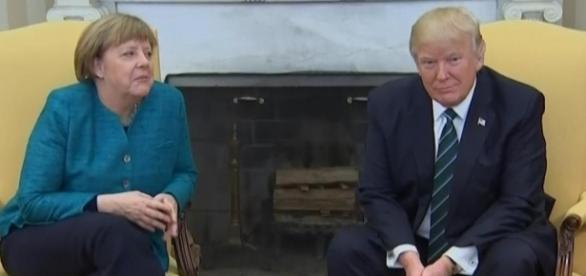 Donald Trump ignores handshake request from Angela Merkel in front ... - thesun.co.uk