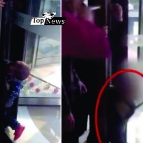 Garoto fica preso em porta giratória