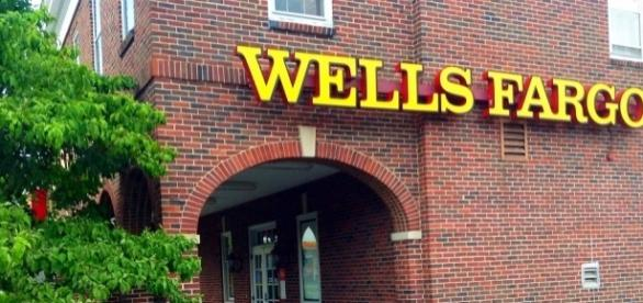 Wells Fargo & Company (NYSE: WFC) has reached a preliminary $110 million settlement over fake customer accounts / Mike Mozart, Flickr CC BY-SA 2.0