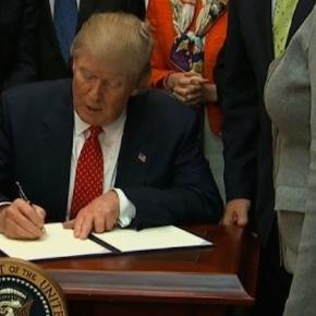 Donald Trump is signing the order. Photo via CNN.com