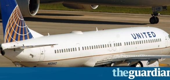 Plane diverted as passengers fight over seat reclining | Business ... - theguardian.com