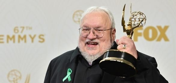"George R.R. Martin holds his Emmy Award for Outstanding Drama Series for ""Game of Thrones."" (via Alberto E. Rodriguez/Getty Images)"