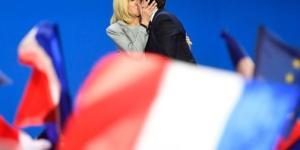 French president Emmanuel Macron kisses his wife Brigitte Trogneux. CREDIT: http://www.harpersbazaar.com