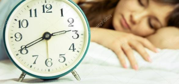 Beautiful sleeping woman with an alarm clock — Stock Photo ... - depositphotos.com