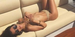 The reality TV star shared a sexy photo as she lounged with her boyfriernd, Younes Bendjima. (Instagram/Kourtney Kardashian)