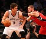 Brook Lopez, starting center for the Brooklyn Nets, backing down Jonas Valanciunas of the Toronto Raptors - nothinbutnets.com
